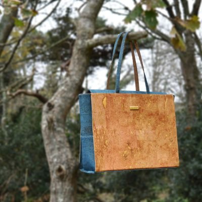 Bag Affair Classy business bag in green cork hanging on tree branch