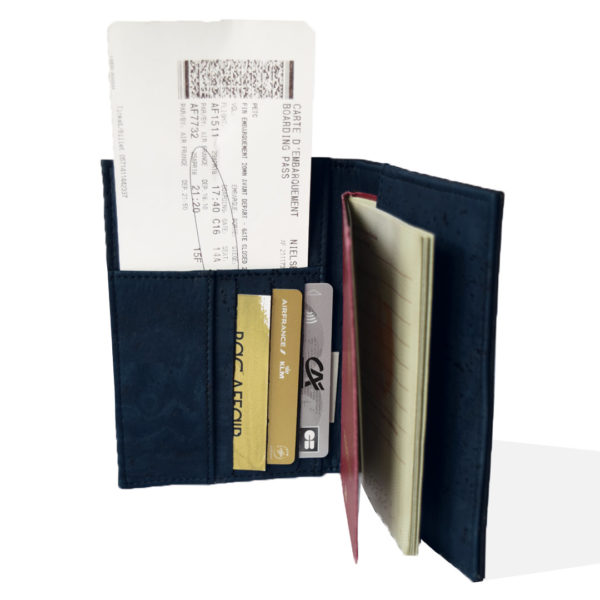 Open view of passport cover in black and marine cork, inside filled with passport, boarding pass and cards