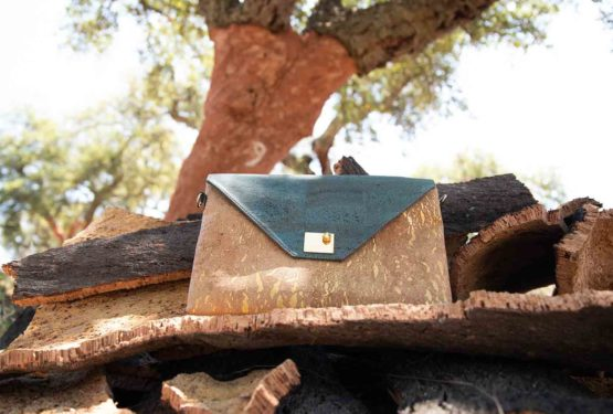 Sassy handbag on cork bark pile in front of a freshly harvested cork oak tree with number 9 written on it